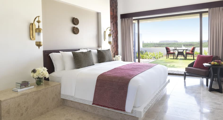 Comfortable Bed of One Bedroom Garden View Villa with Outdoor Views at Al Baleed Resort Salalah
