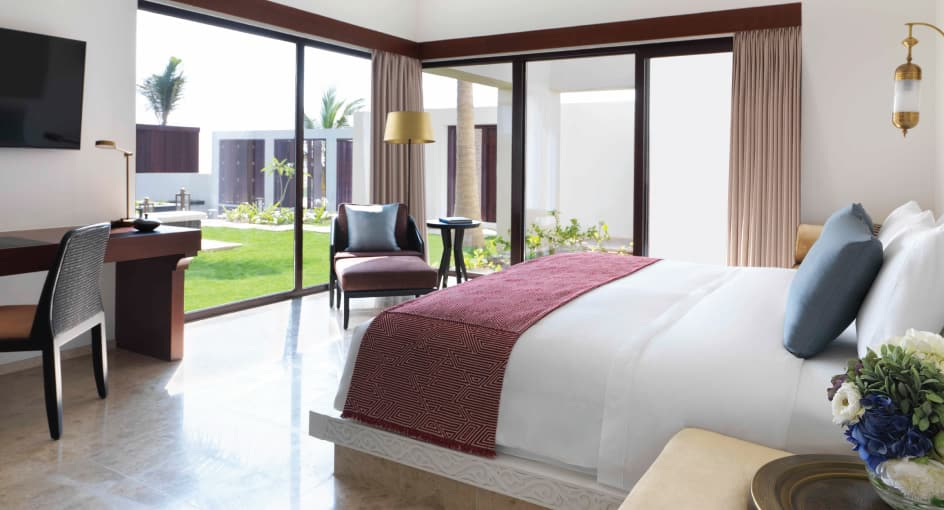 Spacious Bed with Modern Amenities at Three Bedroom Royal Beach Villa of Anantara Oman