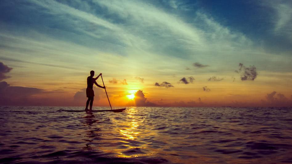 Paddle Boarding During the Sunset in Oman with Anantara Salalah Resort