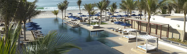 Swimming Pool of the Anantara Oman Resort Overlooking the Pristine Ocean
