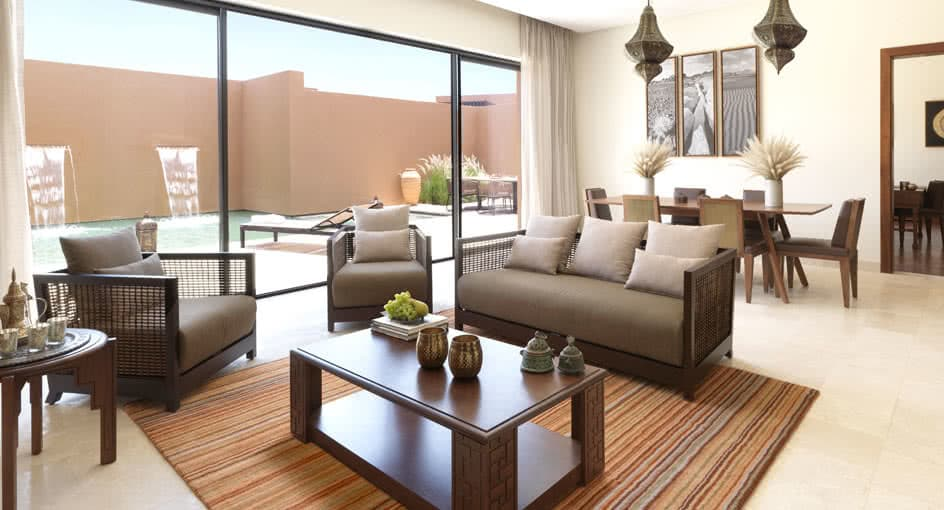 Living Spaces of Garden Pool Villas with Sofas in Nizwa Oman