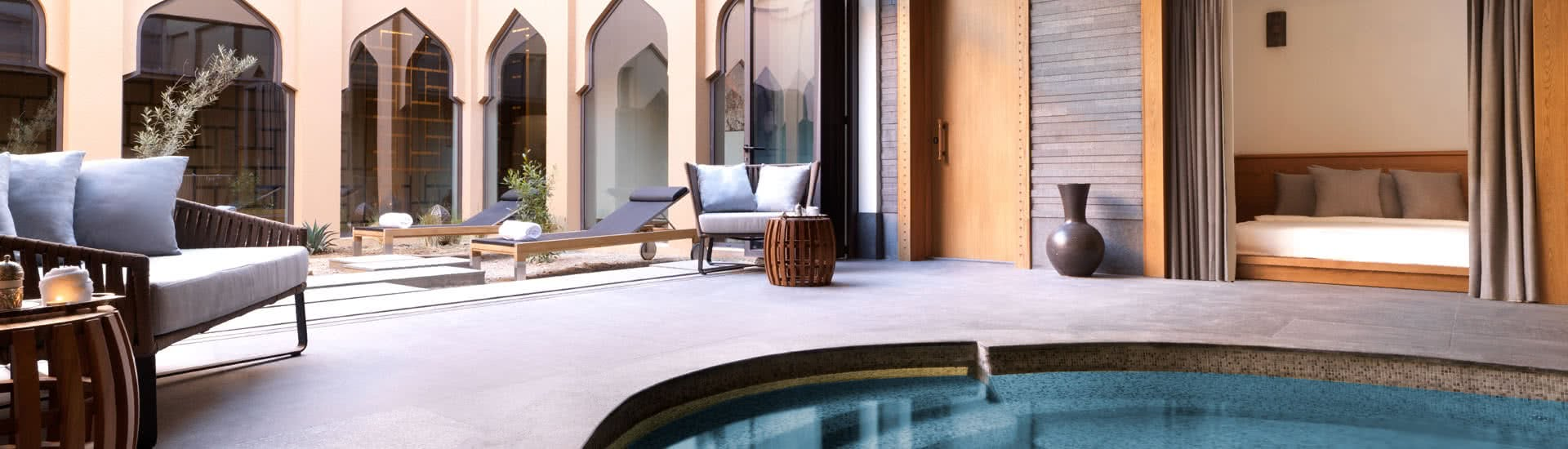 Spa Relaxation Area with Indoor Pool and Loungers at Anantara Jabal Resort