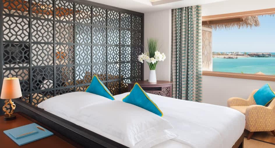 Spacious Bed Overlooking the Ocean at Banana Island Resort Doha