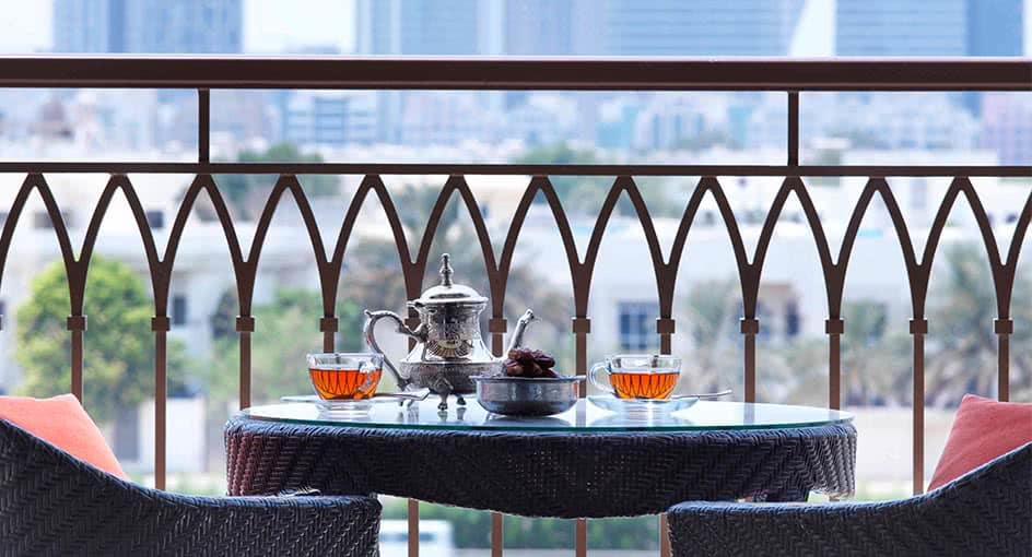 Evening Tea By the Balcony Overlooking the Abu Dhabi City