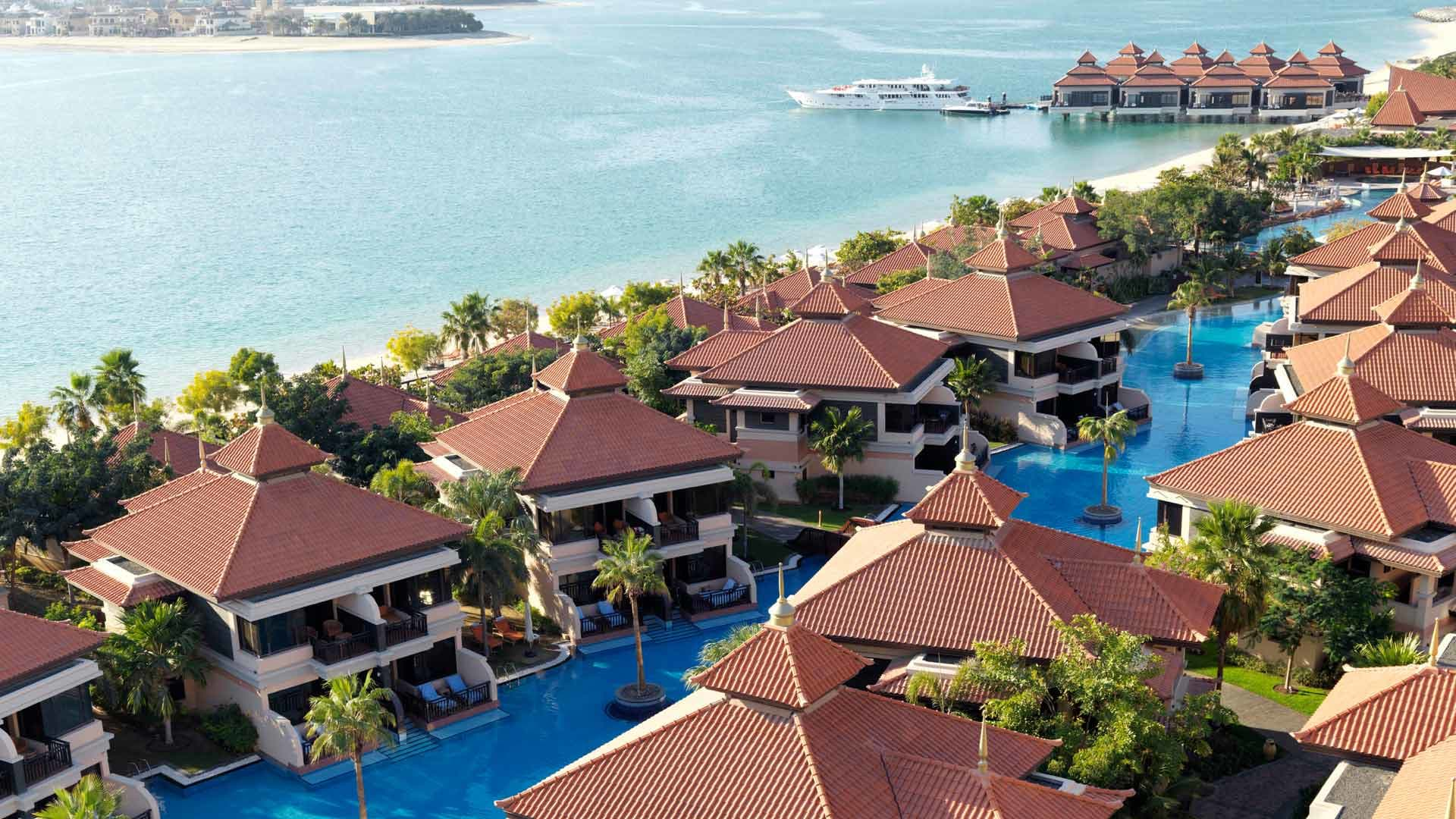 https://assets.anantara.com/image/upload/q_auto/media/minor/anantara/images/anantara-the-palm-dubai-resort/the-resort/anantara_the_palm_exterior_desktop_banner_new_1920x1080.jpg